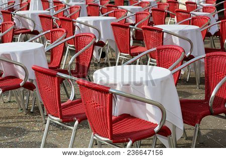 Many Tables And Red Chair In The Alfresco Cafe