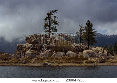 A Mountain Storm Rolls In Over A Boulder Island In The California Mountains