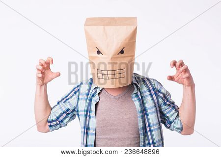 Depressed Angry Man With Picture Emotional Face On Box Over Head.