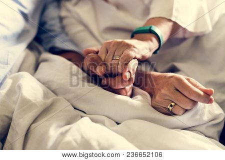 Closeup of couple holding hands together