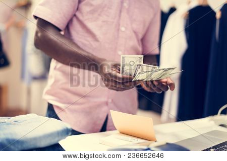 Colleague counting money after work