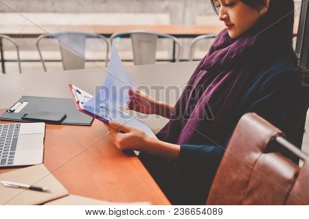 Business Concept.young Asian Businesswoman Is Working Happily.young Businesswoman Working In A Cafe.