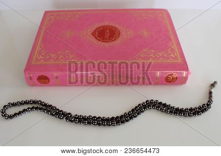 Quran And Rosary Beads Isolated On White Background. Pink Color Koran Book. Allah, Ramadan.
