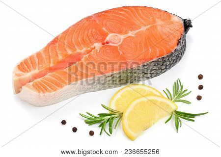 Slice Of Red Fish Salmon With Lemon, Rosemary And Peppercorns Isolated On White Background.
