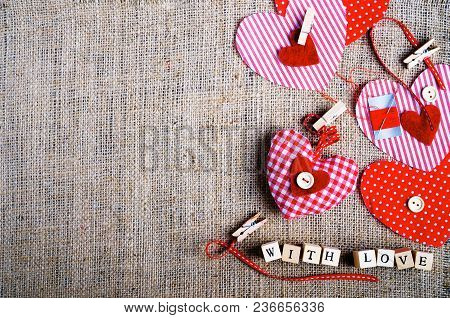 Sewing Set: Fabrics, Threads, Pins, Buttons, Tape And Handmade Hearts On Burlap, Sackcloth Backgroun