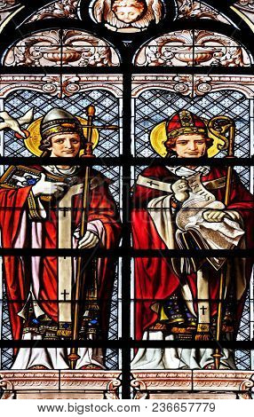 PARIS, FRANCE - JANUARY 10: Saint Gregory and Saint Isidore, stained glass window in the Saint Augustine church in Paris, France on January 10, 2018.