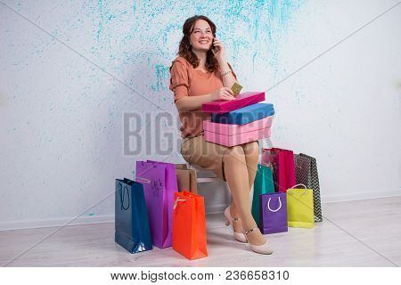 Happy Woman After Shopping With Bags, Boxes, Credit Card, Phone