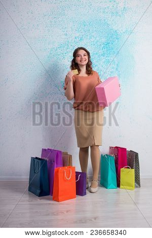 Happy Woman Stands With Shopping Colourful Bags, Boxes, Banking Card