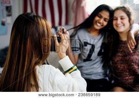 Teenager taking a picture of her friends hobby and photography concept