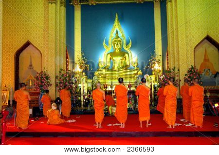 Monks At Prayer In A Temple