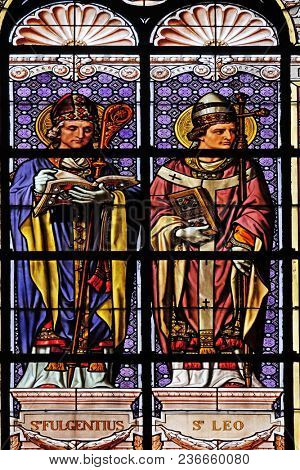 PARIS, FRANCE - JANUARY 10: Saint Fulgentius and Saint Leo, stained glass window in the Saint Augustine church in Paris, France on January 10, 2018.