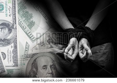 Human Trafficking Concept With A Money Background