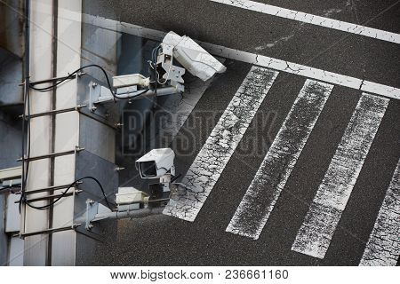 Security Camera On A Pole With Street Background