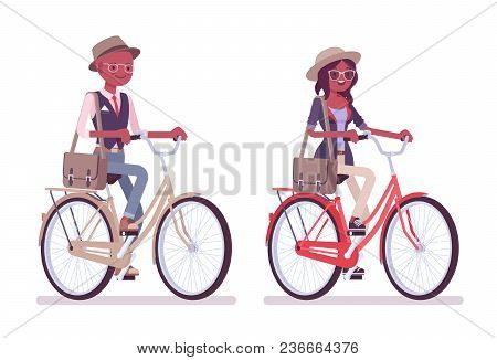 Black Intelligent Smart Casual Man And Attractive Woman Wearing Hat And Glasses, Riding A City Bike.
