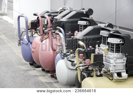 Many New Air Compressors Pressure Pumps Close Up Photo