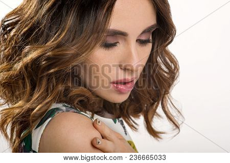 Hair. Beauty Portrait Of Brunette Girl With Volume Shiny Wavy Hair. Woman Posing On White Background