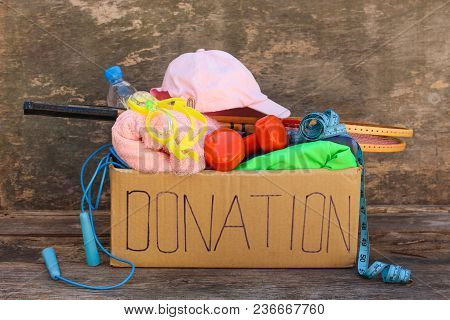 Close Up Donation Box With Sporting Goods