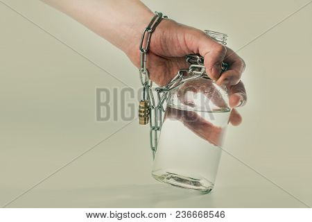 Bottle With Alcohol And Chain