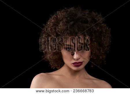 Exotic Curly Girl Looking At Camera And Posing. Wearing Light Day Make Up With Saturated Violet Lips