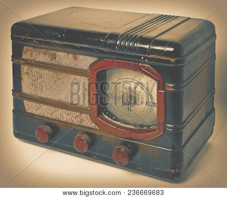 Old Vintage Radio In A Metal Casing. Toned Photo.