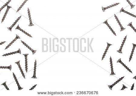 Black Screws Isolated On White Background With Copy Space For Your Text. Top View