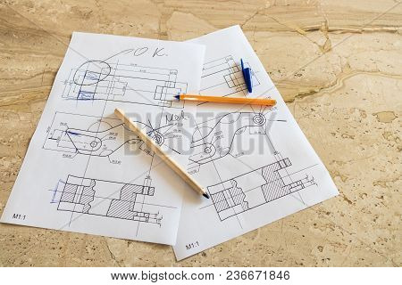 Designing Mechanical Parts Draft On Stone Table With Pen And Pencil