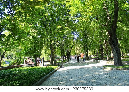 Chernihiv / Ukraine. 06 May 2017: People Have A Rest In City Park With Big Trees And Wide Footpathes