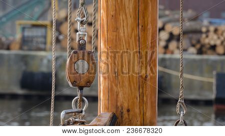 Wooden Pulley And Mast  - Rigging Element On The Yacht