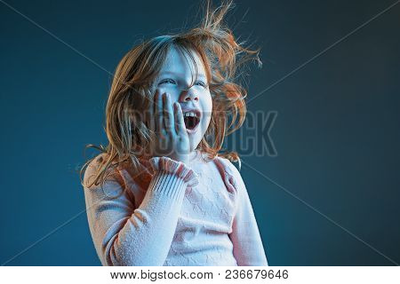 The Anger And Surprised Teen Girl. Hate, Rage. Crying Emotional Angry Teenager In Colorful Bright Li