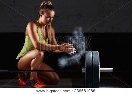 Fitness Female Weightlifter Preparing For Her Workout Chalking Her Hands Magnesia Chalk Preparation