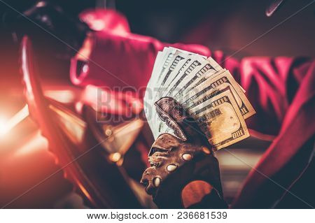 Casino Jackpot Winner With Pile Of One Hundred Dollars Banknotes While Seating Inside His Classic Am