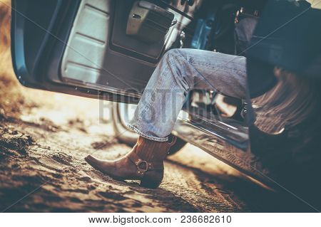 Cowboy And The Classic Muscle Car Taking A Ride. Cowboy Shoes. Leather Boot.