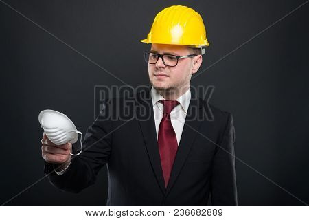 Business Young Man Wearing Hardhat Holding Mask.