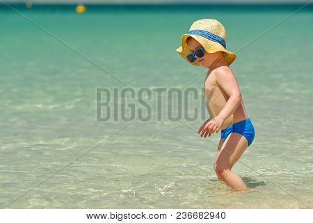 Two year old toddler boy on beach
