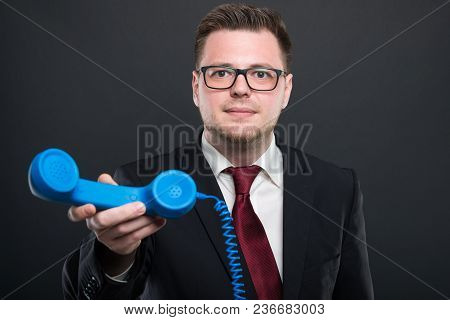 Business Young Man Handing  Blue Telephone Receiver.