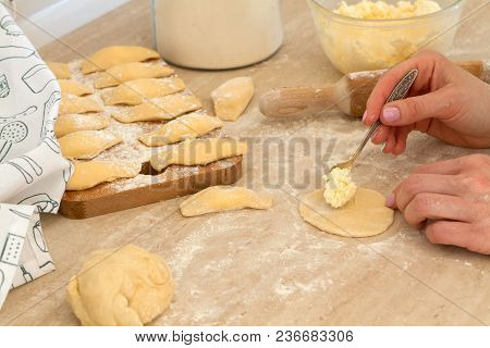 Douhg Preparation For Cooking Dumplings. Womens Hand Cutting Up Dough. Womens Hands In A Process Of