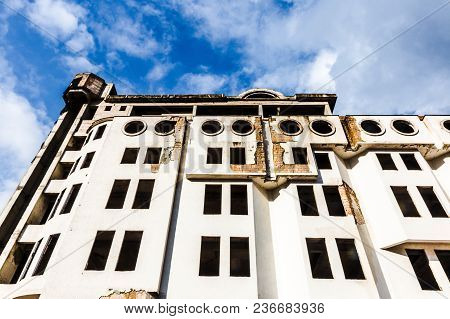 Unfinished Abandoned, Collapsing Building Against The Blue Sky, Photo Below, Background Image