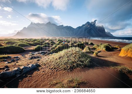 Unique view on the green hills with sand dunes. Location Stokksnes cape, Vestrahorn (Batman Mount), Iceland, Europe. Scenic image of amazing nature capture. Summer scene. Discover the beauty of earth.