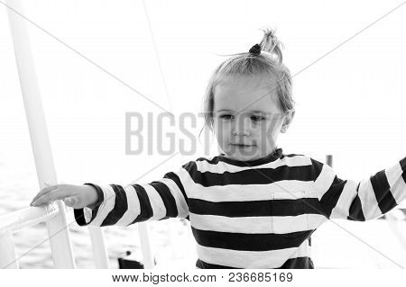 Boy In Sailor Shirt Sail In Blue Sea. Child With Blond Hair On Yacht On Sunny Day. Summer Vacation C