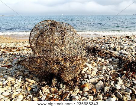 Shrimp Trap Discarded By The Sea On The Beach