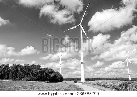 Windmills For Electric Power Production. Green And Alternative Energy Concept
