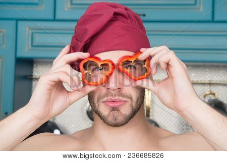 Vegetarian Menu And Healthy Diet. Man With Red Pepper Slices Like Glasses. Cook In Chef Hat With Bar