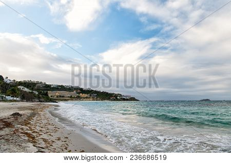 Seascape With Town On Mountain Landscape, Nature. Sea Beach On Cloudy Sky In Philipsburg, Sint Maart