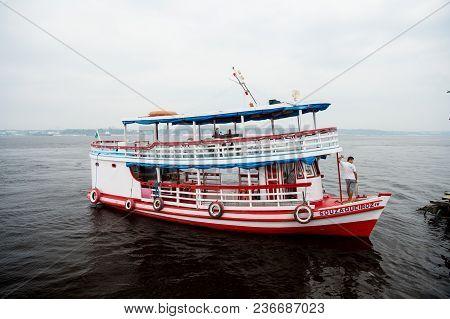 Manaus, Brazil - December 04, 2015: Holiday Cruiser Ship On Seascape. Pleasure Boat Float Along Sea