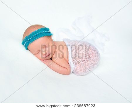 Newborn child sleeping on soft blanket