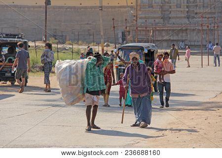 India, Hampi, 02 February 2018. A Scavenger. Indian Man With A Big Bag Of Plastic Bottles. Ecology I