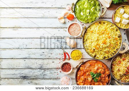Different Bowls With Assorted Indian Food On White Wooden Background, Top View. Dishes And Appetizer