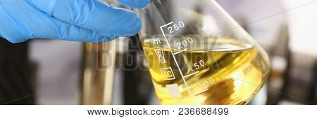 Male Hands In Protective Gloves Hold Test Tube In Hands Produces Chemistry Test Of Motor Oil Automat
