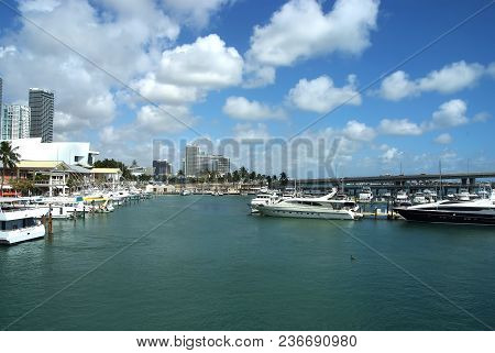 Miami, Usa -september 28, 2008 : City Harbor Waterfront With Boats On Blue Water On Cloudy Sky Backg
