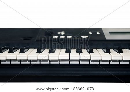 A Photo Of Old Used Synthesizer, Electronic Musical Keyboard Or Piano For Digital Music Recording, A